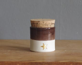 ready made urn or jar. white porcelain clay pottery urn, pet urn or use as a jar. with brown glaze and star shaped stamp in gold