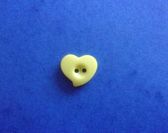 Button heart embossed yellow, 2 holes - 13mmx12mm