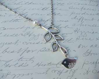 Bird on branch with pearl necklace