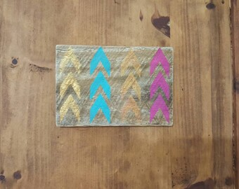 Turquoise, pink, gold Arrow sign on reclaimed wood