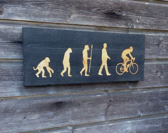 Modern painting / the evolution of man - cyclist / wall decor / 55cmx22cm / painting on wood / paint on wood