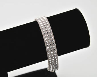 Grey suede and silver studs bracelet