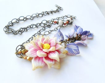 With a lotus flower necklace