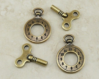 4 TierraCast Pocket Watch Clock and Winding Key Charms Mix Pack > Steampunk - Brass Ox Plated Lead Free Pewter - I ship Internationally