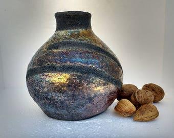 Ceramic decoration made with raku technique. Gres. Handmade around Potter.