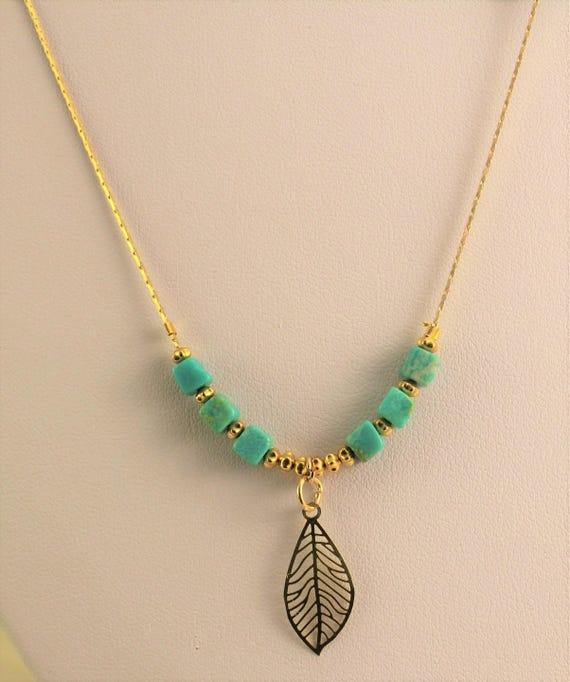 gold plated Bohemian chic necklace with leaf and turquoise gemstones