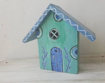 Wooden hand-painted house
