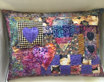 vintage style patchwork quilted cushion
