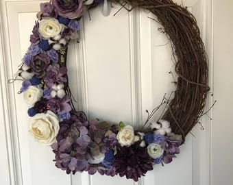 Floral wreath | Grapevine wreath accented with fabric flowers in shades of purple and creams