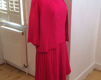 hot pink 1960s pleated skirt suit