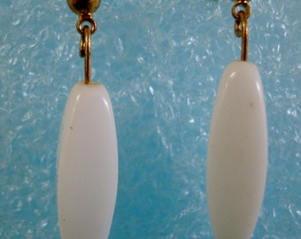 Snow white drops are 1 1/2 inch long. glass Beads are RECLAIMED from BROKEN 1940's NECKLACE