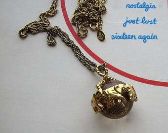 vintage pool of light necklace with elephants, long gold chain . Premier Designs glass orb necklace pendant