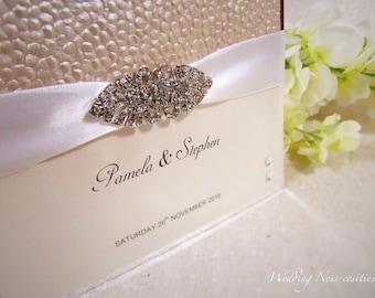 Cream Pebble Embossed Wedding Invitation