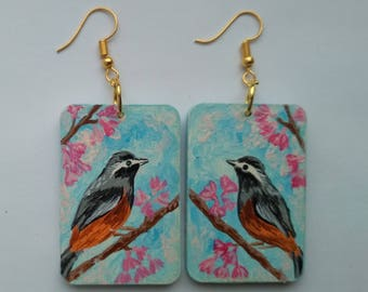 wooden earrings with a picture of a bird