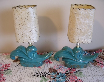 Pair of Mid Century Deco Spray Swirled Wave Shaped Base Turquoise Lamps with Fiberglass Shades
