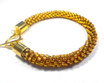 Chic Topaz gold bracelet woven on a Kumihimo braid