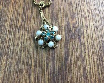 Hand knotted pearls with a vintage aqua rhinestone filigree pendant