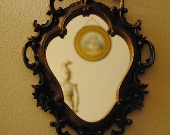 Plastic framed small wall mirror