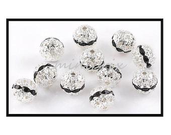 Filigree X 4 round beads with 10mm black rhinestones.
