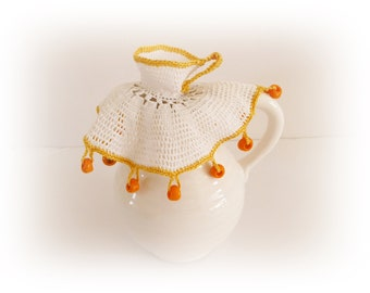 Vintage white crochet jug cover cup and saucer and orange beads