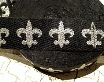 7/8 Silver Metallic FLEUR de LIS on Black Woven Ribbon sold by the yard