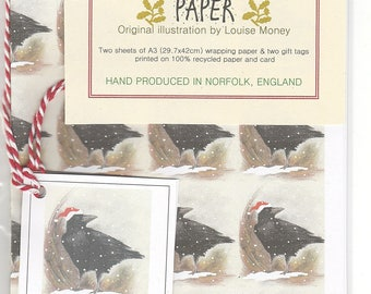 Crow Christmas wrapping paper. wrapping paper with a crow. gift wrap with a crow. crow gift wrap. crow art. crow paper. crow gift. corvid