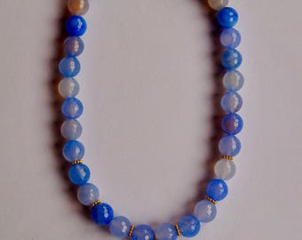 Necklace length scarf, blue and faceted dyed agate with a bronze pendant and black rhinestones