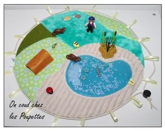 "poncho ""Otter"" travel mat, travel games"