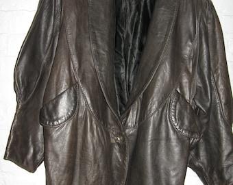 1980's black leather jacket with large gathered sleeves