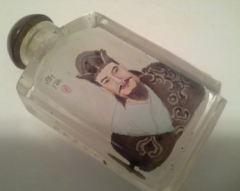 Chinese man design on glass snuff bottle