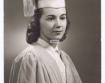 Graduate,1950's.Cap.Tassle.Curls.Memorabilia,Historical.Student.gift.dorm.university.high school.cape gown.portrait.original.black and white
