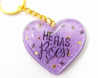 "Purple ""He Has Risen"" Resin Heart Key Chain 