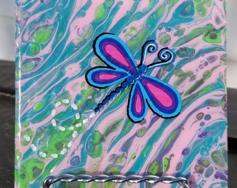 Hand-painted tile with poured fluid art background and dragonfly