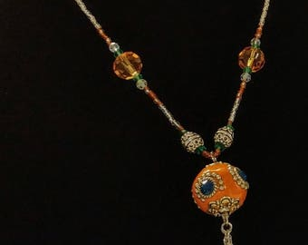 Orange beaded necklace with tassel