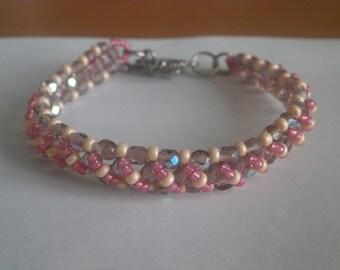 "Bracelet ""pink, orange, purple"" tones."