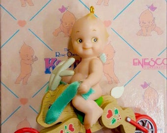 Vintage 1993 Retired Enesco KEWPIE Figurine Riding On a Wooden Reindeer Tricycle Hanging Toy Ornament Rose O'NEILL 23 Yrs. Old New In Box