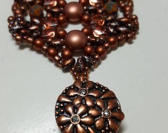 Wide beaded  bracelet in shades of copper