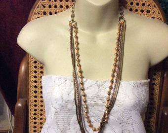 Vintage 1950's all metal beads multi strand necklace. Designer