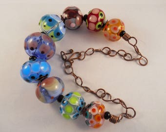 lampwork multi-colored transparent blown hollow bead and oxidized copper wire necklace
