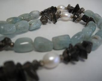 Aquamarine, smokey quartz, and freshwater pearl necklace.