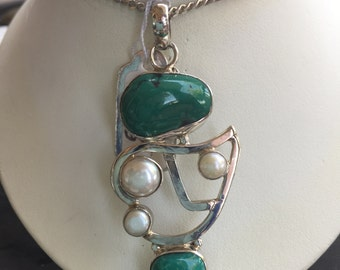 Turquoise and pearl pendant in silver