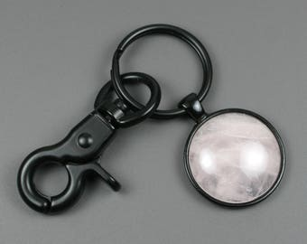 Rose quartz stone keychain in a black bezel setting with an optional swivel lobster claw