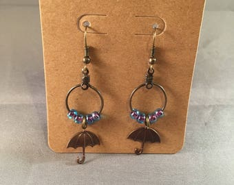 Umbrella Dangle Hoop Earrings: featuring iridescent blue seed beads and brass umbrella charms