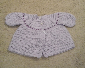 Hand crocheted sweater with ribbon trim