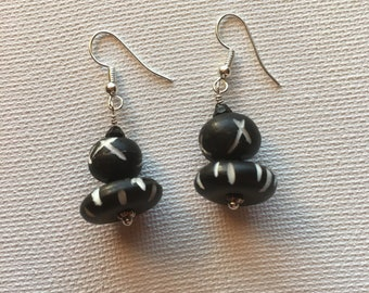 Black dangle earrings.  Black drop earrings. Black and white earrings.  On silver ear wire.