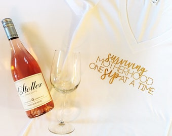 Surviving Motherhood one Sip at a time. Surviving Motherhood. Mother's Day gift. Gift for mom. One Sip at a time. mom and wine. Mothers day