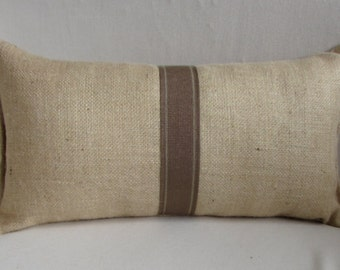 blonde burlap lumbar pillow with decorative tape in earth