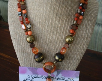 Unique Wood, orange and brass Necklace