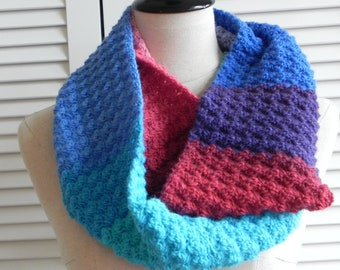 Crochet infinity scarf in multi-color yarn, shades of blue, turquoise, purple, red and pink, ready to ship