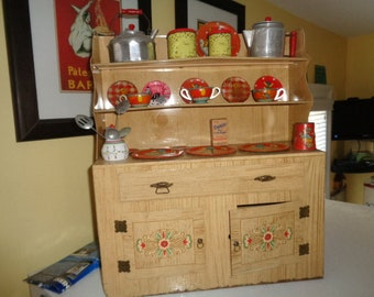 Large Kitschy Wolverine Toy Hoosier cupboard Cabinet with retro toy dishes
